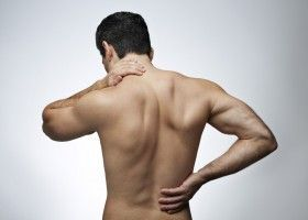 Болить спина після тренування: що робити?