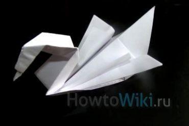 Як зробити з паперу лебедя?